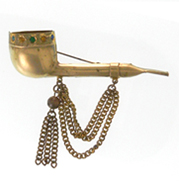 gold pipe brooch