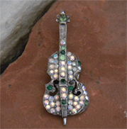 Beautiful vintage violin or cello brooch with multi-colored crystals and intricate details