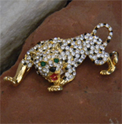 Exquisite cheetah vintage brooch with black enamel droplets amid the many rhinestones