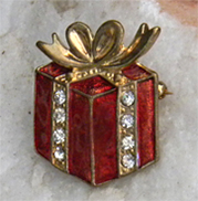 Festive red and gold vintage enamel brooch decorated with rhinestones.