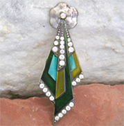 Unique enamel vintage brooch with green enamel and rhinestones