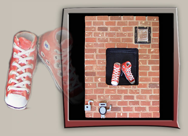 street scene with brick wall and red sneakers