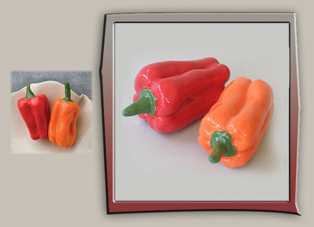 life-size sculptures of red and orange bell peppers