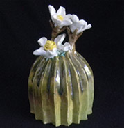 stoneware cactus with white flowers