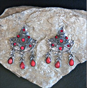 red dangles on silver triangles earrings