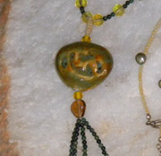 green ceramic pendant necklace with complimentary beads