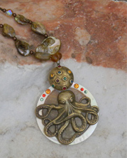 chunky designer necklace with bronze colored metal octopus pendant and shells