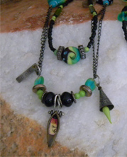 designer necklace with green glass beads and chain with industrial charms