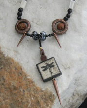designer necklace with hipster dragonfly, bronze accents and 					black beads