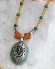 designer beaded necklace with mystery symbol and amber crystals