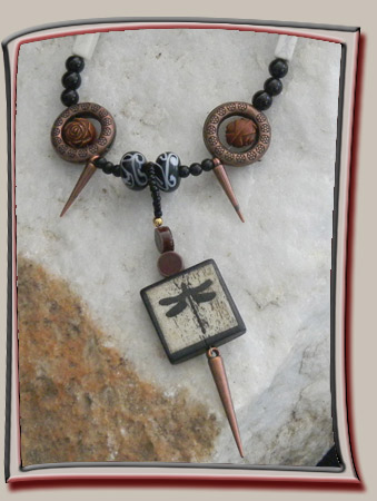 Dragonfly pendant with dart accents