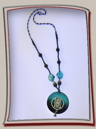 Teal shell with abstract metalwork
