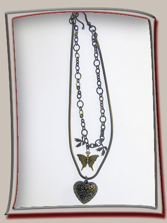 below heart pendant is dainty bronze butterfly and leaves for a layered necklace composition