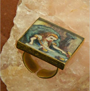 ring has scene from Alice in Wonderland
