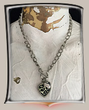 Silver chain with animal print heart and charms necklace