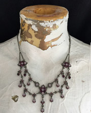 Charming bib necklace with multi-faceted lavender wire-wrapped beads