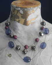 Triple-strand choker with large Lucite baubles