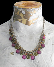 necklace with magenta faceted beads with elaborate chain